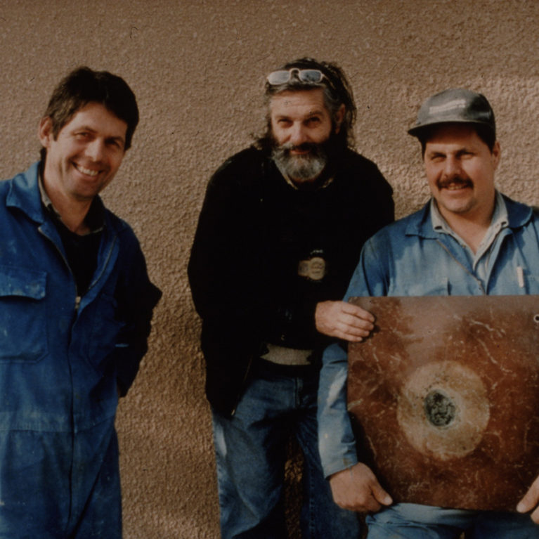 Mario Tassinari  and Sören and Stig Thor with fossil meteorite